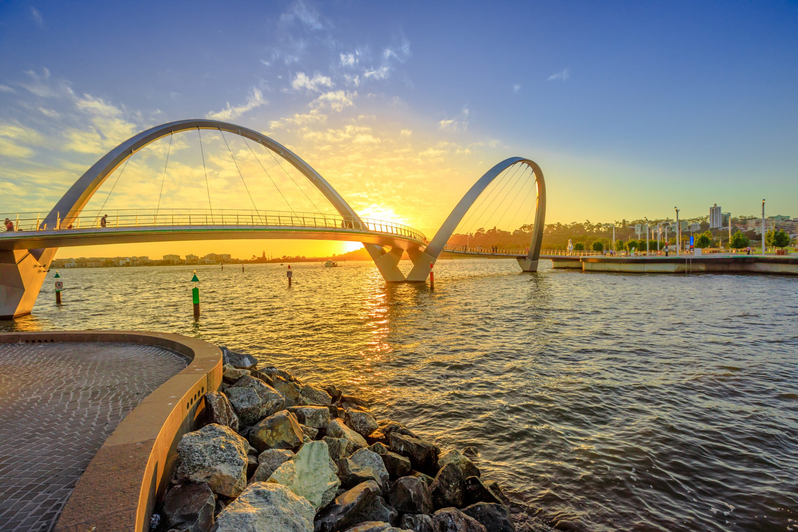 Scenic and iconic Elizabeth Quay Bridge at sunset light on Swan River at entrance of Elizabeth Quay marina. The arched pedestrian bridge is a new tourist attraction in Perth, Western Australia.
